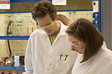 Marta Antoniv '17 talks with Visiting Assistant Professor of Chemistry Daniel Griffith '07.