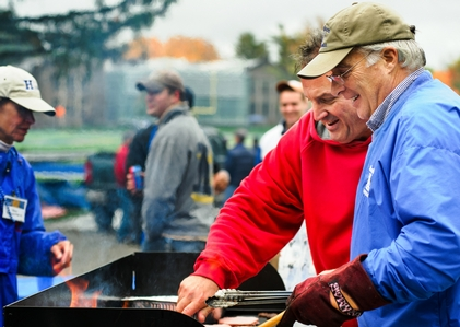 Paul Zarella P'12 and Jim Rishel '74 cook hotdogs and burgers during the tailgate party at Steuben Field. (PHOTO BY MEGAN P. HAMAN)