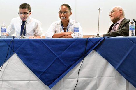 "Hector Acevedo '08, Leide Cabral '11 and Roberts Moses '56 lead the panel discussion, ""We the People."""