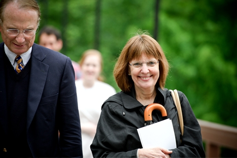 Hamilton College President Joan Hinde Stewart makes her way across the bridge to watch the Reunion Parade.