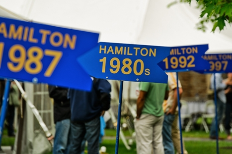 Class signs for the Reunion Parade line the Dunham Green.