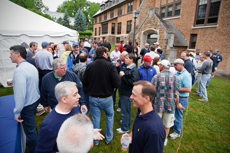 Alumni socialize at the Psi Upsilon house party during reunion weekend on Friday, June 1, 2012.