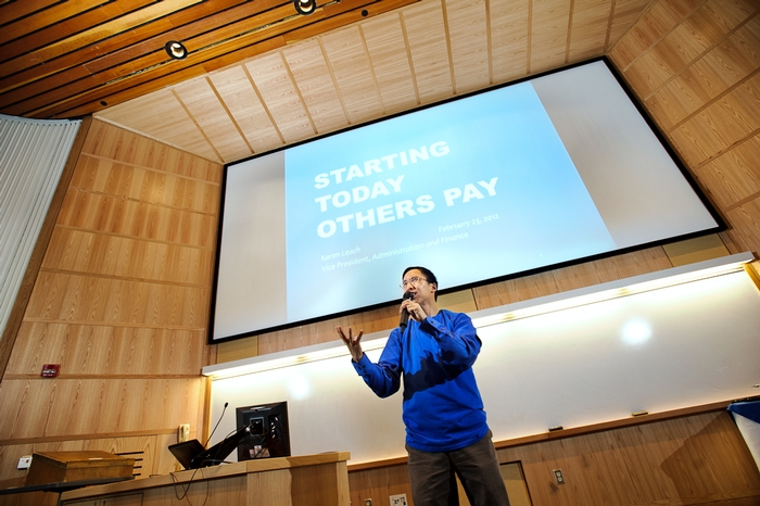 Associate Professor of Economics Stephen Wu took questions at the day's opening presentation.