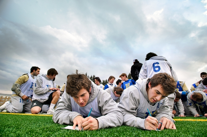 The Hamilton College Lacrosse team signs thank you cards during practice on Thursday, February 23, 2012.