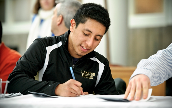 Tony Hernandez &apos;17 writes a thank you note.<br />Photo: Nancy L. Ford
