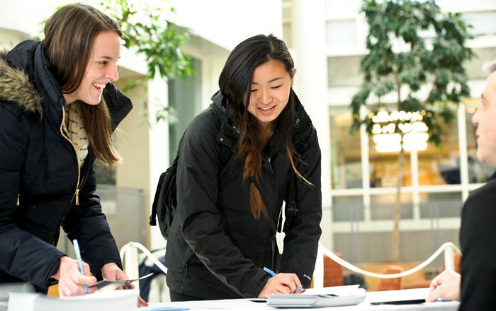 Rachel Williams &apos;17, left, and Jean Chen &apos;17, right, sign Thank You cards.<br />Photo: Nancy L. Ford