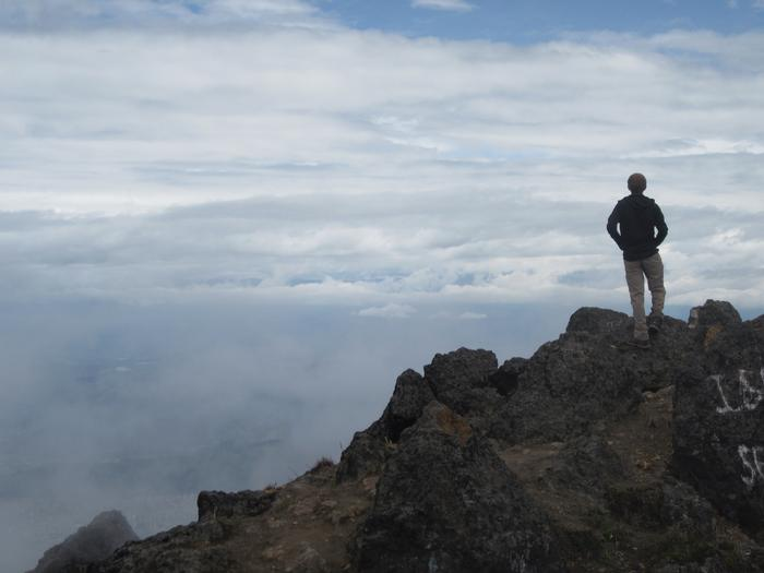 Peter Laciano '13 on top of Rucu Pichincha. PHOTO: BY DANI FORSHAY '11