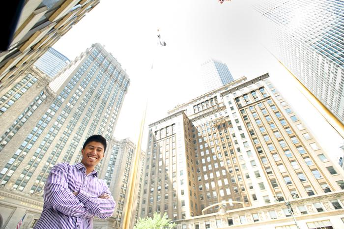Ujjwal Pradhan '15 poses outside of his internship at Priority Capital Management.
