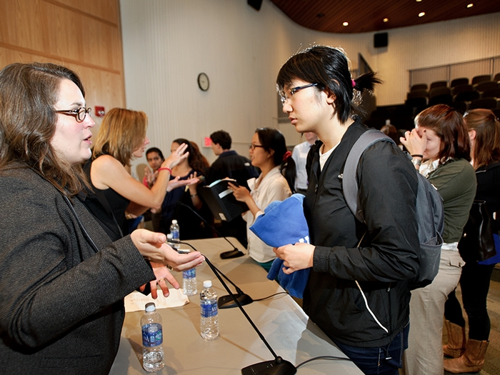 Alysia Mihalakos '01 talks to students after a panel discussion on Public Health Context and Challenges.