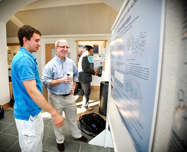 Dan Mermelsten '14 talks to his father about his project. (PHOTO BY NANCY L. FORD)