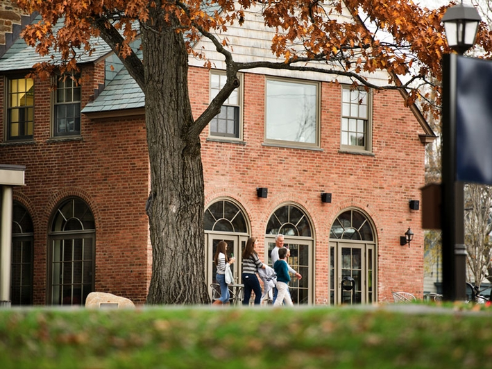 A family walks by the Sadove Student Center at Emerson Hall. (PHOTO BY NANCY L. FORD)