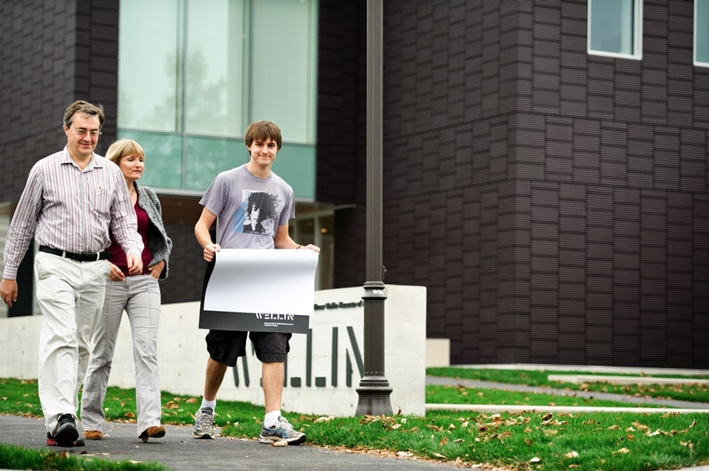 Alex Host '13 and his parents, Winnie and Chris, walk from the Wellin Museum. (PHOTO BY NANCY L. FORD)