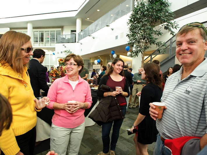 Parents and students mingle with faculty. (PHOTO BY NANCY L. FORD)