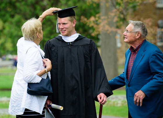 Nate Somes gets his tassel adjusted after the ceremony.<br />Photo: Nancy L. Ford