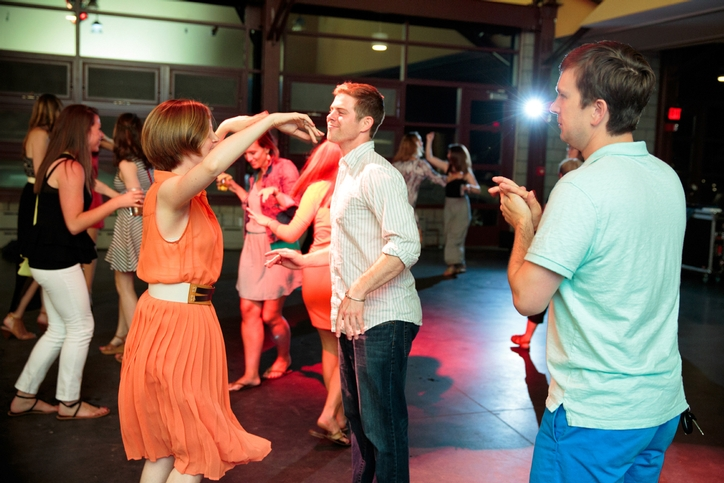 Alumni dance to the sounds of Steak Nite at the Saturday Night Dance Party.<br />Photo: Chris M. Penree