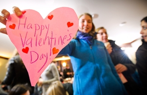 Anne Liozeaux '12 shows off a Valentine she made at the decorating event.