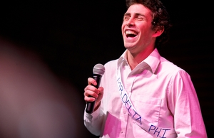 Mr. Delta Phi Alex Hayes '14 sings during the competition.