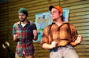 Greg Scott '14, left, and contestant Jim Anesta '14, right, get a little hip action going in a dance routine.