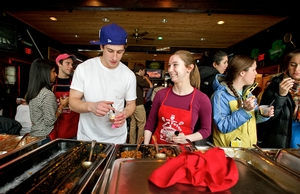Contestant Jane Roust '12, right, looks to Sam Nidenberg as he tries her chili.