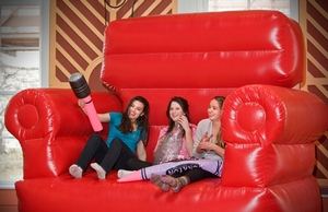 Students pose for a picture in a giant inflatable chair at the FebFest carnival.
